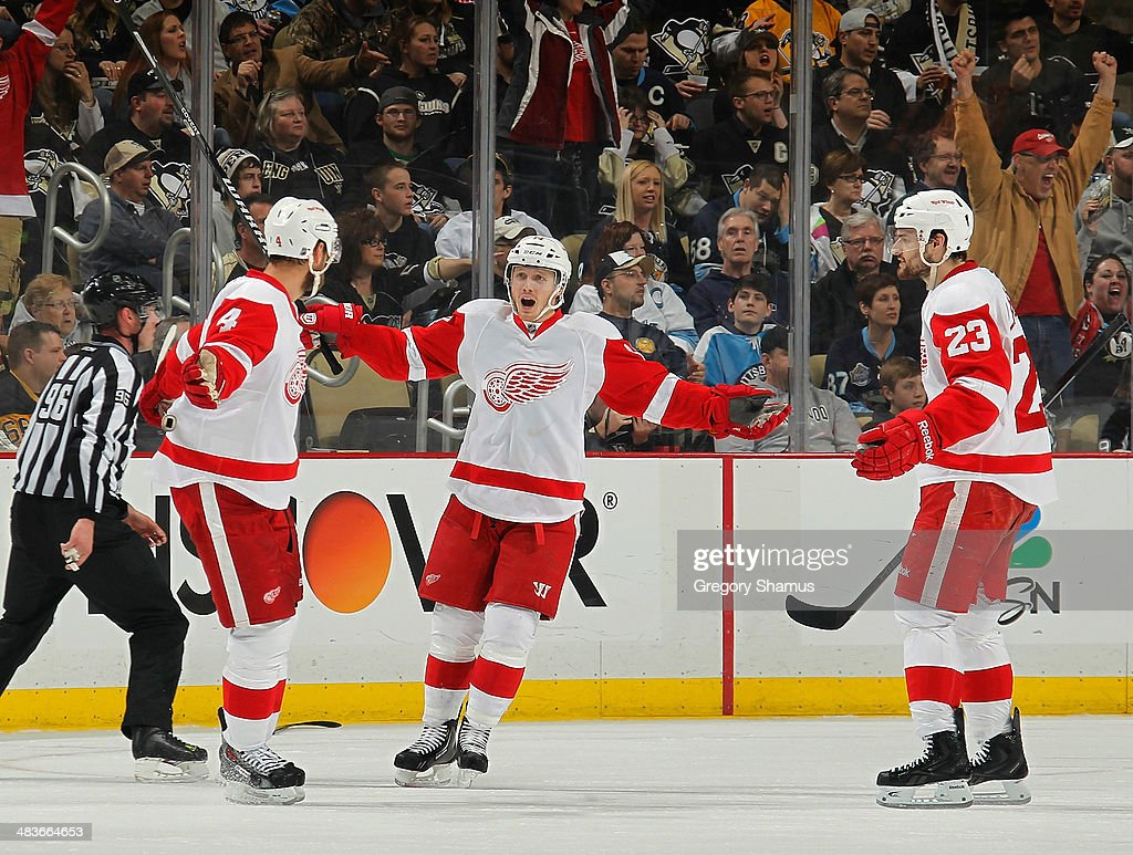 Jakub Kindl #4 celebrates his goal with teammates Gustav Nyquist #14 and Brian Lashoff #23 of the Detroit Red Wings during the second period against the Pittsburgh Penguins on April 9, 2014 at Consol Energy Center in Pittsburgh, Pennsylvania.