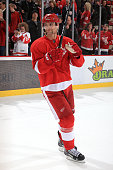 Jakub Kindl of the Detroit Red Wings acknowledges the crowd after being named one of the three stars of a NHL game against the New Jersey Devils on...