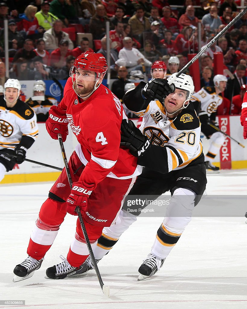<a gi-track='captionPersonalityLinkClicked' href=/galleries/search?phrase=Jakub+Kindl&family=editorial&specificpeople=716743 ng-click='$event.stopPropagation()'>Jakub Kindl</a> #4 of the Detroit Red Wings and <a gi-track='captionPersonalityLinkClicked' href=/galleries/search?phrase=Daniel+Paille&family=editorial&specificpeople=706561 ng-click='$event.stopPropagation()'>Daniel Paille</a> #20 of the Boston Bruins battle for position with the puck in the air during an NHL game at Joe Louis Arena on November 27, 2013 in Detroit, Michigan. Detroit defeated Boston 6-1