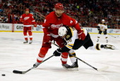 Jakub Kindl of the Detroit Red Wings battles for the puck against Reilly Smith of the Boston Bruins of Game Four of the First Round of the 2014 NHL...