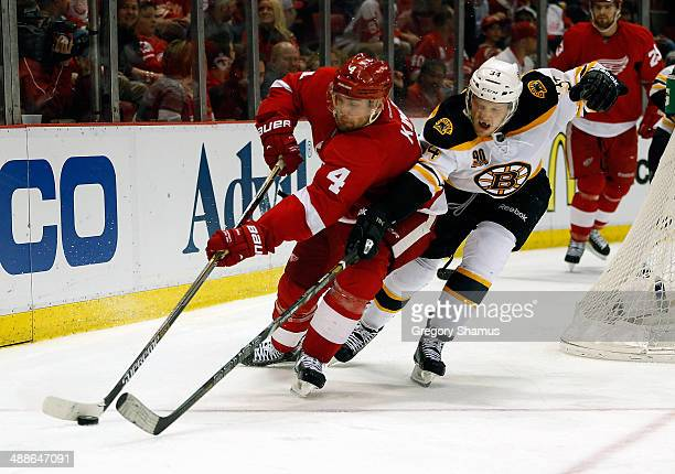 Jakub Kindl of the Detroit Red Wings battles for the puck against Carl Soderberg of the Boston Bruins of Game Four of the First Round of the 2014 NHL...