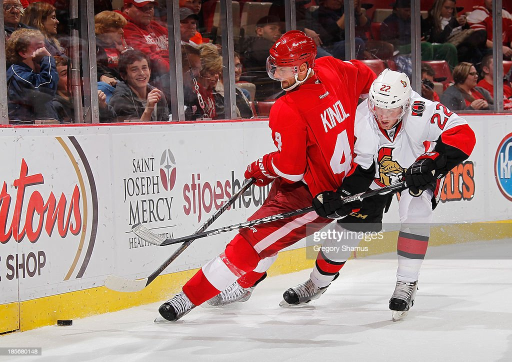 <a gi-track='captionPersonalityLinkClicked' href=/galleries/search?phrase=Jakub+Kindl&family=editorial&specificpeople=716743 ng-click='$event.stopPropagation()'>Jakub Kindl</a> #4 of the Detroit Red Wings battles for the puck with <a gi-track='captionPersonalityLinkClicked' href=/galleries/search?phrase=Erik+Condra&family=editorial&specificpeople=6254234 ng-click='$event.stopPropagation()'>Erik Condra</a> #22 of the Ottawa Senators during the third period at Joe Louis Arena on October 23, 2013 in Detroit, Michigan. Ottawa won the game 6-1.