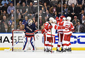 Jakub Kindl of the Detroit Red Wings celebrates a goal with his teamates against Henrik Lundqvist of the New York Rangers during there game at...