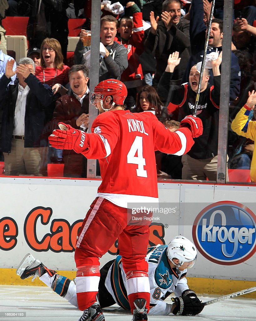 <a gi-track='captionPersonalityLinkClicked' href=/galleries/search?phrase=Jakub+Kindl&family=editorial&specificpeople=716743 ng-click='$event.stopPropagation()'>Jakub Kindl</a> #4 of the Detroit Red Wings celebrates after scoring a goal as <a gi-track='captionPersonalityLinkClicked' href=/galleries/search?phrase=Joe+Pavelski&family=editorial&specificpeople=687042 ng-click='$event.stopPropagation()'>Joe Pavelski</a> #8 of the San Jose Sharks lays on the ice during a NHL game at Joe Louis Arena on April 11, 2013 in Detroit, Michigan. San Jose defeated Detroit 3-2 in a shoot-out