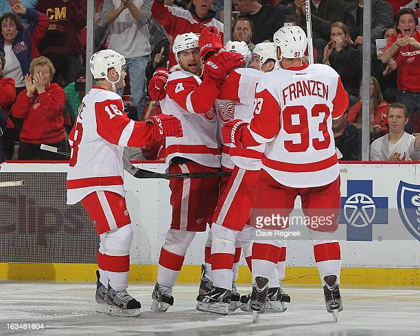Jakub Kindl of the Detroit Red Wings celebrates his goal with Pavel Datsyuk Johan Franzen Justin Abdelkader and Ian White during an NHL game against...
