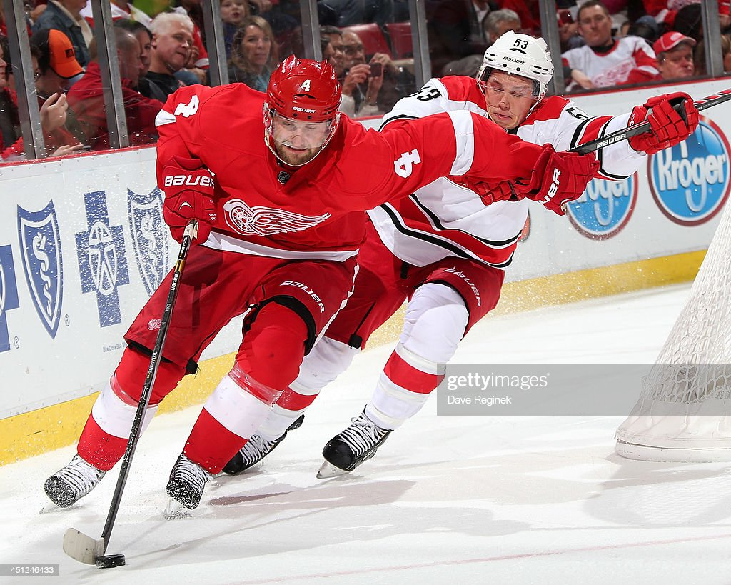 <a gi-track='captionPersonalityLinkClicked' href=/galleries/search?phrase=Jakub+Kindl&family=editorial&specificpeople=716743 ng-click='$event.stopPropagation()'>Jakub Kindl</a> #4 of the Detroit Red Wings circles the net and protects the puck from <a gi-track='captionPersonalityLinkClicked' href=/galleries/search?phrase=Jeff+Skinner&family=editorial&specificpeople=3147596 ng-click='$event.stopPropagation()'>Jeff Skinner</a> #53 of the Carolina Hurricanes during an NHL game at Joe Louis Arena on November 21, 2013 in Detroit, Michigan.
