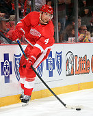 Jakub Kindl of the Detroit Red Wings clear the puck during a NHL game against the Los Angeles Kings on October 31 2014 at Joe Louis Arena in Detroit...