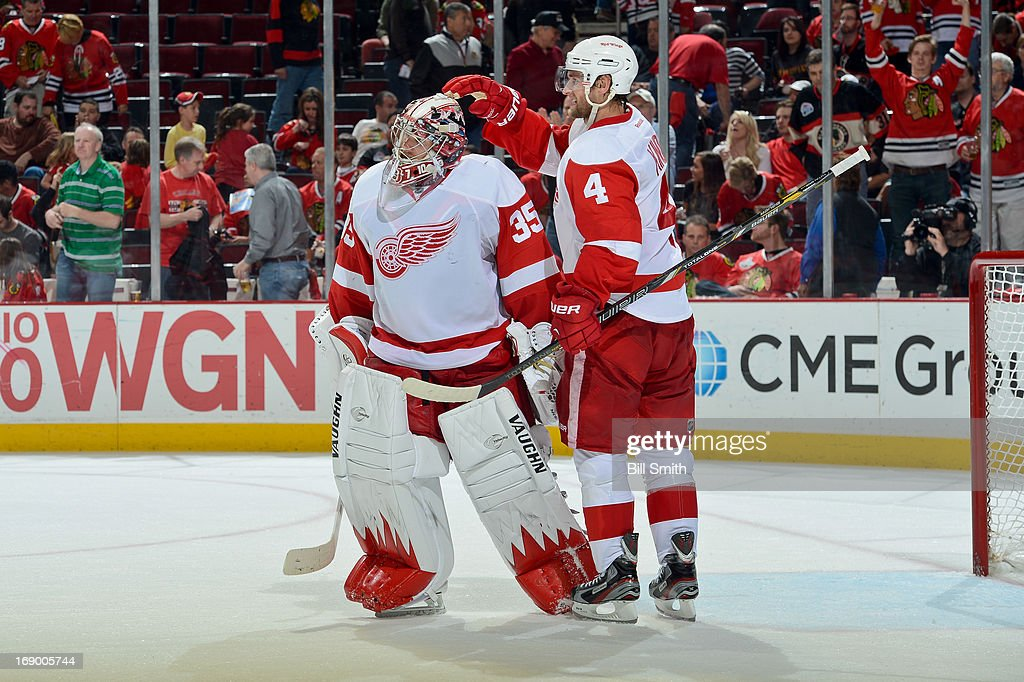 Jakub Kindl #4 of the Detroit Red Wings congratulates teammate goalie Jimmy Howard #35 after the Red Wings defeated the Chicago Blackhawks 4-1 in Game Two of the Western Conference Semifinals during the 2013 Stanley Cup Playoffs at the United Center on May 18, 2013 in Chicago, Illinois.