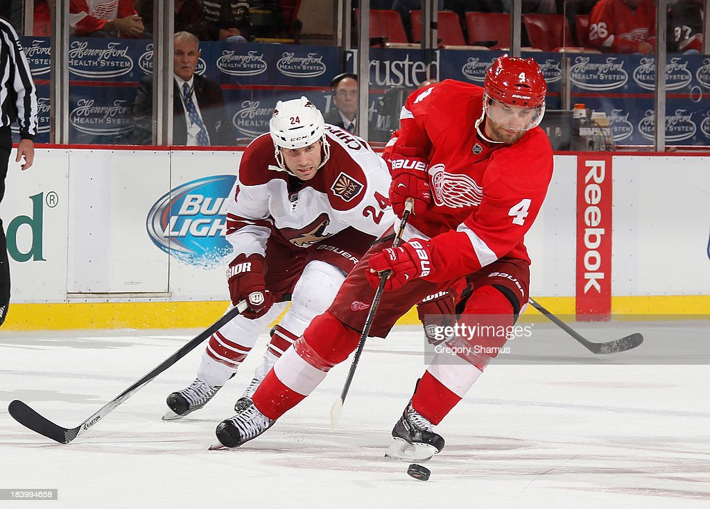 <a gi-track='captionPersonalityLinkClicked' href=/galleries/search?phrase=Jakub+Kindl&family=editorial&specificpeople=716743 ng-click='$event.stopPropagation()'>Jakub Kindl</a> #4 of the Detroit Red Wings controls the puck in front of <a gi-track='captionPersonalityLinkClicked' href=/galleries/search?phrase=Kyle+Chipchura&family=editorial&specificpeople=879784 ng-click='$event.stopPropagation()'>Kyle Chipchura</a> #24 of the Phoenix Coyotes during the third period at Joe Louis Arena on October 10, 2013 in Detroit, Michigan. Phoenix won the game 4-2.