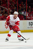 Jakub Kindl of the Detroit Red Wings controls the puck in the first period against the Washington Capitals during an NHL Game at Verizon Center on...