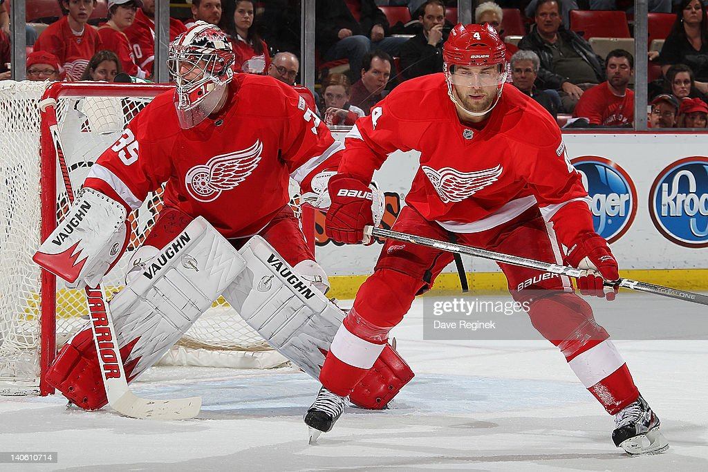 <a gi-track='captionPersonalityLinkClicked' href=/galleries/search?phrase=Jakub+Kindl&family=editorial&specificpeople=716743 ng-click='$event.stopPropagation()'>Jakub Kindl</a> #4 of the Detroit Red Wings defends net with teammate <a gi-track='captionPersonalityLinkClicked' href=/galleries/search?phrase=Jimmy+Howard&family=editorial&specificpeople=2118637 ng-click='$event.stopPropagation()'>Jimmy Howard</a> #35 during an NHL game against the Minnesota Wild at Joe Louis Arena on March 2, 2012 in Detroit, Michigan. Wings win 6-0.