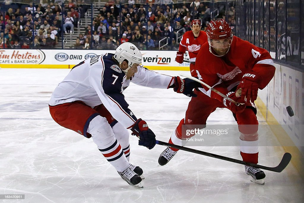 <a gi-track='captionPersonalityLinkClicked' href=/galleries/search?phrase=Jakub+Kindl&family=editorial&specificpeople=716743 ng-click='$event.stopPropagation()'>Jakub Kindl</a> #4 of the Detroit Red Wings flips the puck past Jack Johnson #7 of the Columbus Blue Jackets during the third period on March 9, 2013 at Nationwide Arena in Columbus, Ohio. Columbus defeated Detroit 3-0.