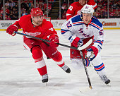 Jakub Kindl of the Detroit Red Wings follows the play and tries to slow down Carl Hagelin of the New York Rangers during a NHL game on December 6...