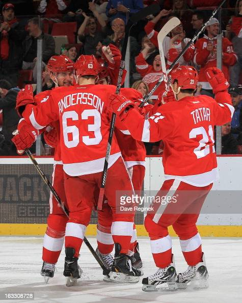 Jakub Kindl of the Detroit Red Wings gets surrounded by teamates Patrick Eaves Joakim Andersson and Tomas Tatar after scoring a goal in a NHL game...
