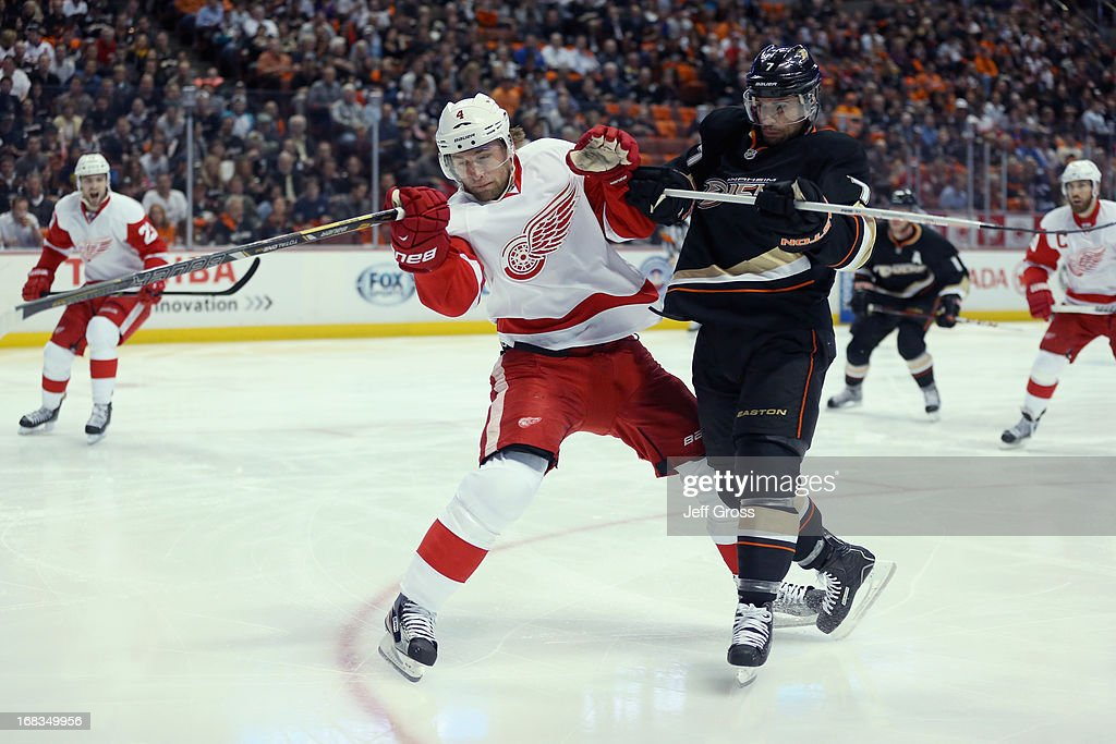 <a gi-track='captionPersonalityLinkClicked' href=/galleries/search?phrase=Jakub+Kindl&family=editorial&specificpeople=716743 ng-click='$event.stopPropagation()'>Jakub Kindl</a> #4 of the Detroit Red Wings is checked by <a gi-track='captionPersonalityLinkClicked' href=/galleries/search?phrase=Andrew+Cogliano&family=editorial&specificpeople=869296 ng-click='$event.stopPropagation()'>Andrew Cogliano</a> #7 of the Anaheim Ducks in the first period in Game Five of the Western Conference Quarterfinals during the 2013 NHL Stanley Cup Playoffs at Honda Center on May 8, 2013 in Anaheim, California. The Ducks defeated the Red Wings 3-2 in overtime.