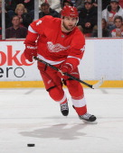Jakub Kindl of the Detroit Red Wings passes the puck against the Washington Capitals during an NHL game on January 31 2014 at Joe Louis Arena in...