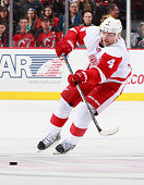 Jakub Kindl of the Detroit Red Wings plays the puck against the New Jersey Devils during the game at the Prudential Center on November 28 2014 in...