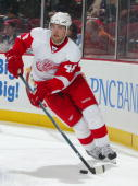 Jakub Kindl of the Detroit Red Wings plays the puck against the New Jersey Devils during their game at the Prudential Center on December 5 2009 in...