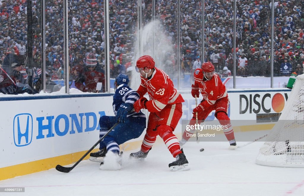 <a gi-track='captionPersonalityLinkClicked' href=/galleries/search?phrase=Jakub+Kindl&family=editorial&specificpeople=716743 ng-click='$event.stopPropagation()'>Jakub Kindl</a> #4 of the Detroit Red Wings plays the puck as teammate Brian Lashoff #23 of the Detroit Red Wings cuts off Jerry D'Amigo #29 of the Toronto Maple Leafs behind the net in the second period during the 2014 Bridgestone NHL Winter Classic on January 1, 2014 at Michigan Stadium in Ann Arbor, Michigan.