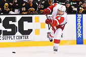 Jakub Kindl of the Detroit Red Wings shoots the puck against the Boston Bruins at the TD Garden on November 14 2015 in Boston Massachusetts