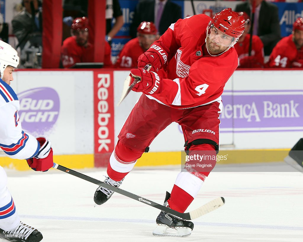 <a gi-track='captionPersonalityLinkClicked' href=/galleries/search?phrase=Jakub+Kindl&family=editorial&specificpeople=716743 ng-click='$event.stopPropagation()'>Jakub Kindl</a> #4 of the Detroit Red Wings shoots the puck against the New York Rangers during an NHL game at Joe Louis Arena on October 26, 2013 in Detroit, Michigan. The Rangers win in O