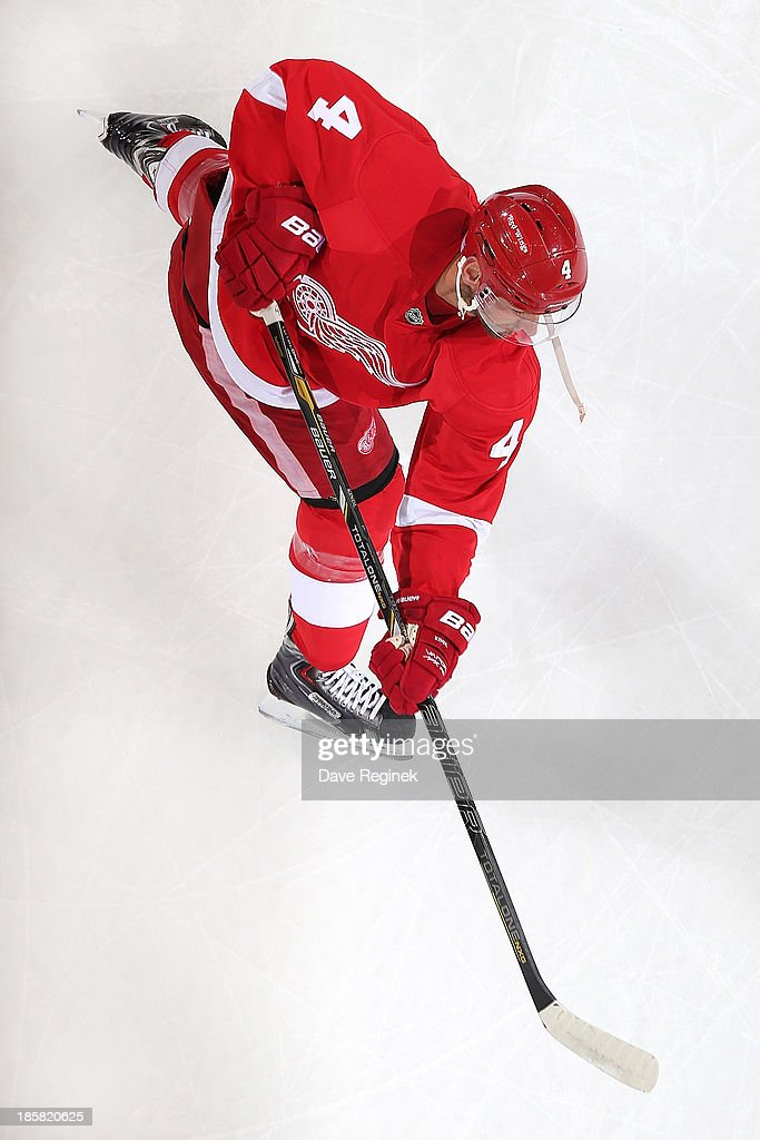 Jakub Kindl #4 of the Detroit Red Wings shoots the puck in warm ups before an NHL game against the San Jose Sharks at Joe Louis Arena on October 21, 2013 in Detroit, Michigan. San Jose Sharks win in a shoot-out 1-0
