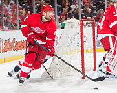 Jakub Kindl of the Detroit Red Wings skates around the net with the puck during an NHL game against the Washington Capitals at Joe Louis Arena on...