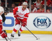 Jakub Kindl of the Detroit Red Wings skates up ice with the puck against the Pittsburgh Penguins during an NHL game on March 20 2014 at Joe Louis...
