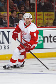 Jakub Kindl of the Detroit Red Wings skates with the puck against the Ottawa Senators at Canadian Tire Centre on December 27 2014 in Ottawa Ontario...