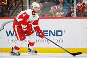 Jakub Kindl of the Detroit Red Wings skates with the puck against the Minnesota Wild during the game on December 28 2015 at the Xcel Energy Center in...