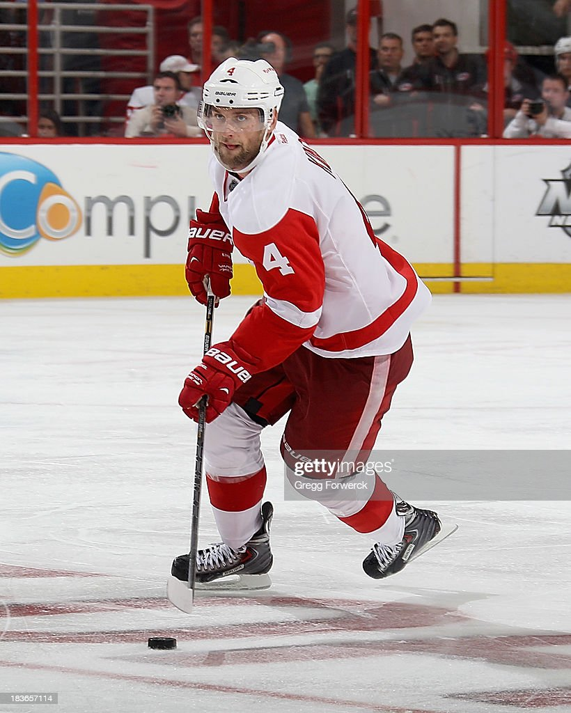 Jakub Kindl #4 of the Detroit Red Wings skates with the puck during an NHL game against the Caroina Hurricanes on October 4, 2013 at PNC Arena in Raleigh, North Carolina.