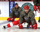Jakub Kindl of the Detroit Red Wings stretches in warmups while wearing his 'Camo' jersey in honor of the servicemen and women as part of Military...
