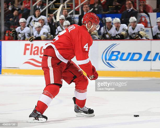 Jakub Kindl of the Detroit Red Wings takes a slap shot during an NHL game against the Pittsburgh Penguins at Joe Louis Arena on December 14 2013 in...