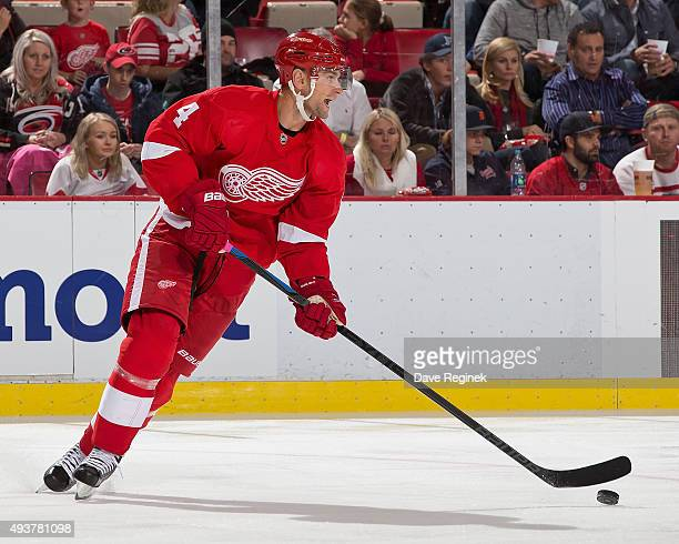 Jakub Kindl of the Detroit Red Wings turns up ice with the puck during an NHL game against the Carolina Hurricanes at Joe Louis Arena on October 16...