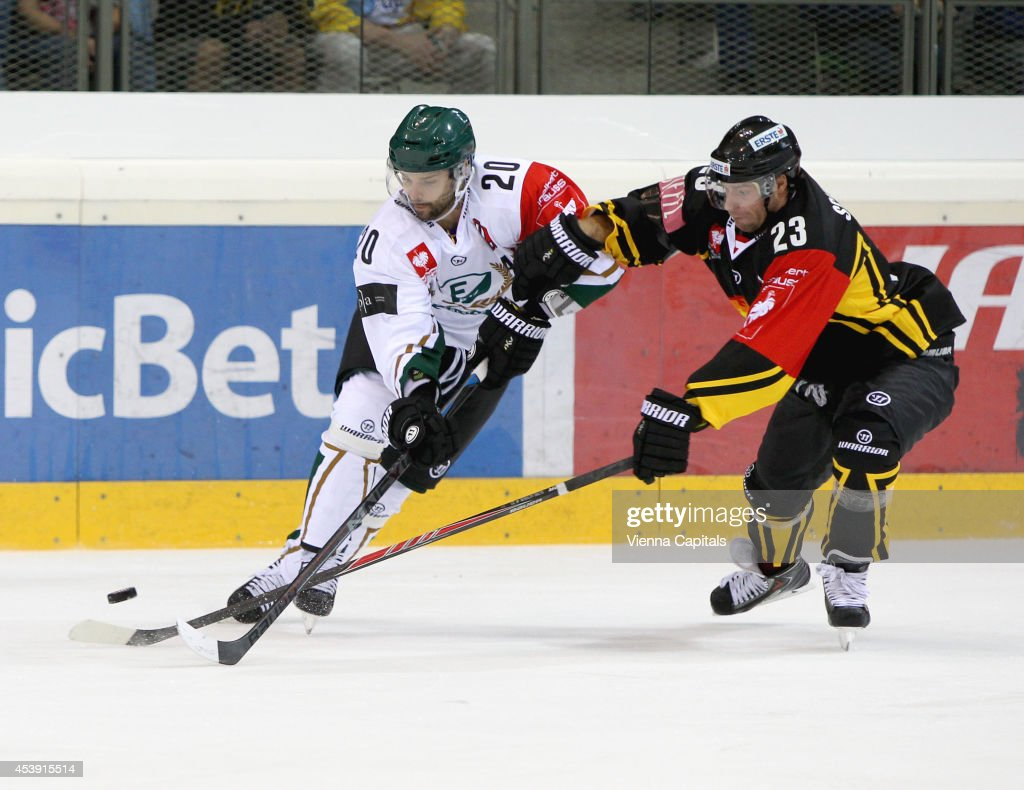 Jakub Klepis (Faerjestad) and Markus Schlacher (Capitals) in action during the Champions Hockey League group stage game between Vienna Capitals and Faerjestad Karlstad on August 21, 2014 in Vienna, Austria.