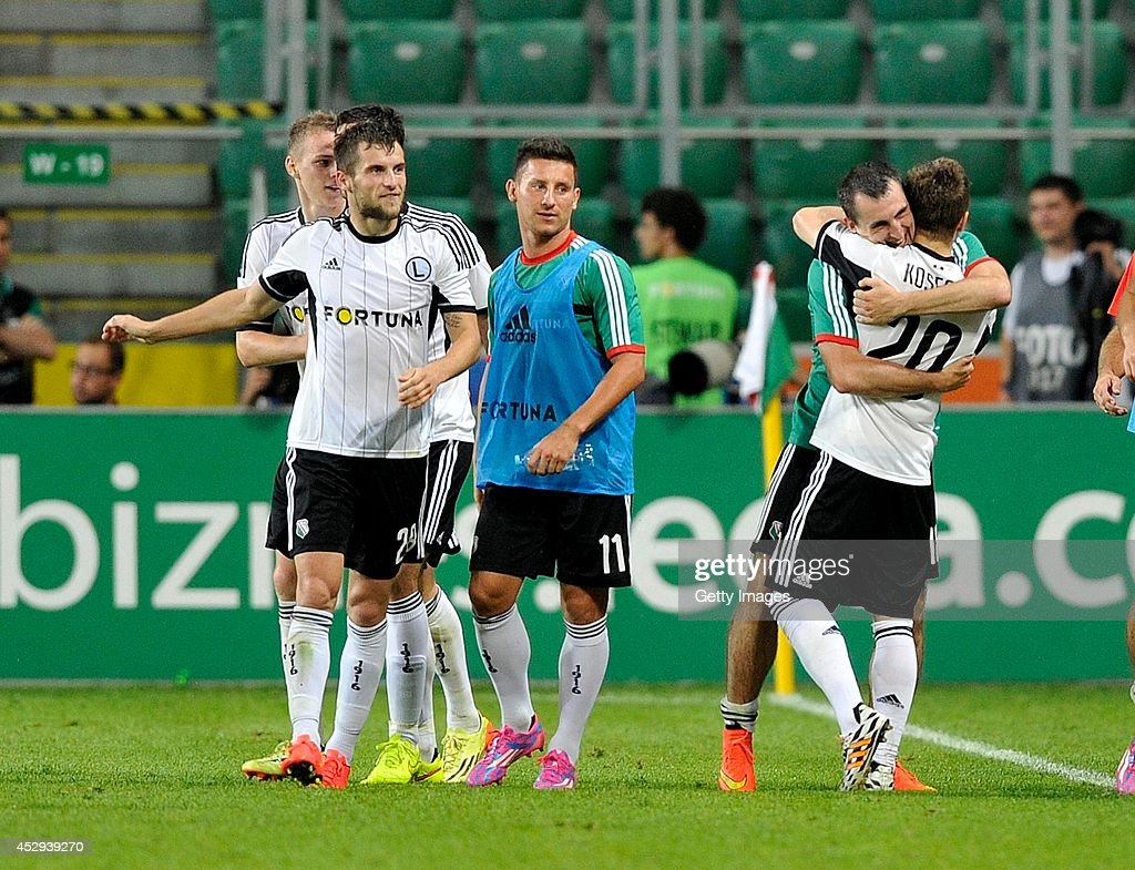 Jakub Kosecki of Legia celebrates after scoring with team mates during the third qualifying round UEFA Champions League match between Legia and Celtic at Pepsi Arena on July 30, 2014 in Warsaw, Poland.