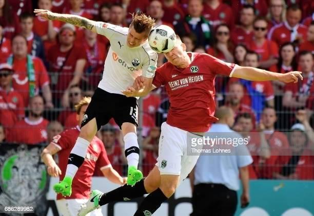 Jakub Kosecki of Sandhausen challanges against Waldemar Anton of Hannover during the Second Bundesliga match between SV Sandhausen and Hannover 96 at...