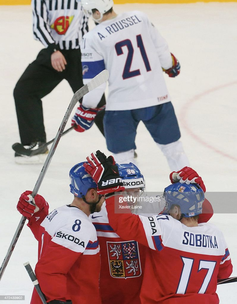 Jakub Krejcik #30 of Czech Republic celebrate a goal with team-mattes and Antoine Roussel #21 of France is disapointed during the 2015 IIHF World Championship between Czech Republic and France at O2 arena on May 7, 2015 in Prague, Czech Republic.