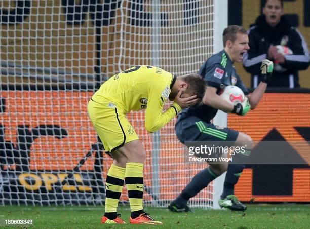 Jakub Kuba Blaszczykowski of Dortmund reacts after missing a penalty against Bernd Leno of Leverkusen during the Bundesliga match between Bayer 04...