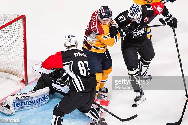 Jakub Nakdalal Simon Gysbers and Teemu Nurmi in action during the Champions Hockey League round of 16 first leg game between TPS Turku and Lukko...