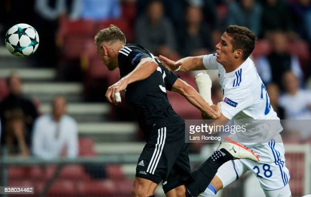 Jakub Rzezniczak of Qarabag FK and Pieros Sotiriou of FC Copenhagen compete for the ball during the UEFA Champions League Playoff 2nd Leg match...
