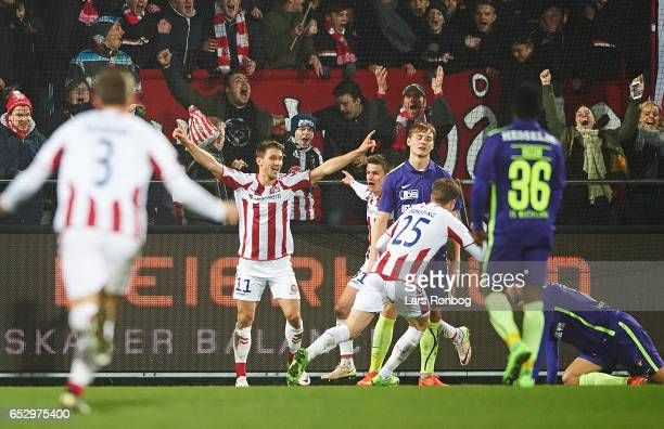 Jakub Sylvestr and Frederik Borsting of AaB Aalborg celebrate after scoring their first goal during the Danish Alka Superliga match between AaB...