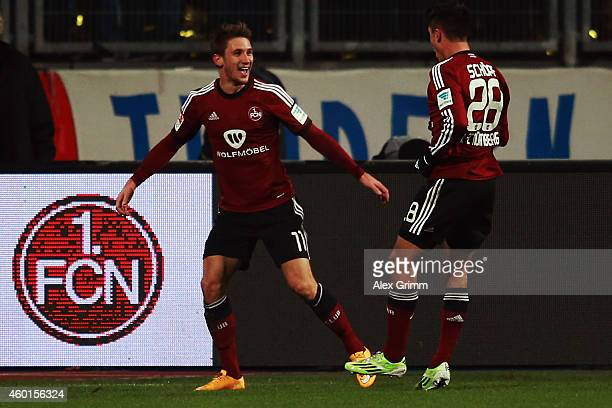 Jakub Sylvestr of Nuernberg celebrates his team's second goal with team mate Alessandro Schoepf during the Second Bundesliga match between 1 FC...