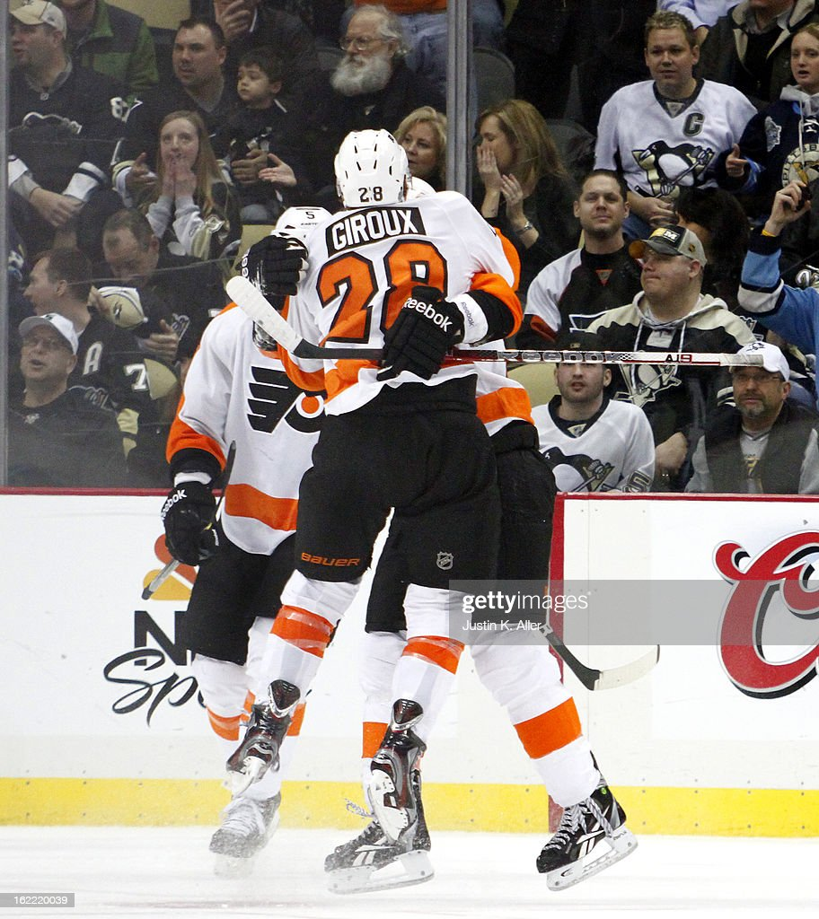 Jakub Voracek #93 and Claude Giroux #28 of the Philadelphia Flyers celebrate after Voracek's third goal of the game against the Pittsburgh Penguins during the game at Consol Energy Center on February 20, 2013 in Pittsburgh, Pennsylvania. The Flyers defeated the Penguins 6-5.