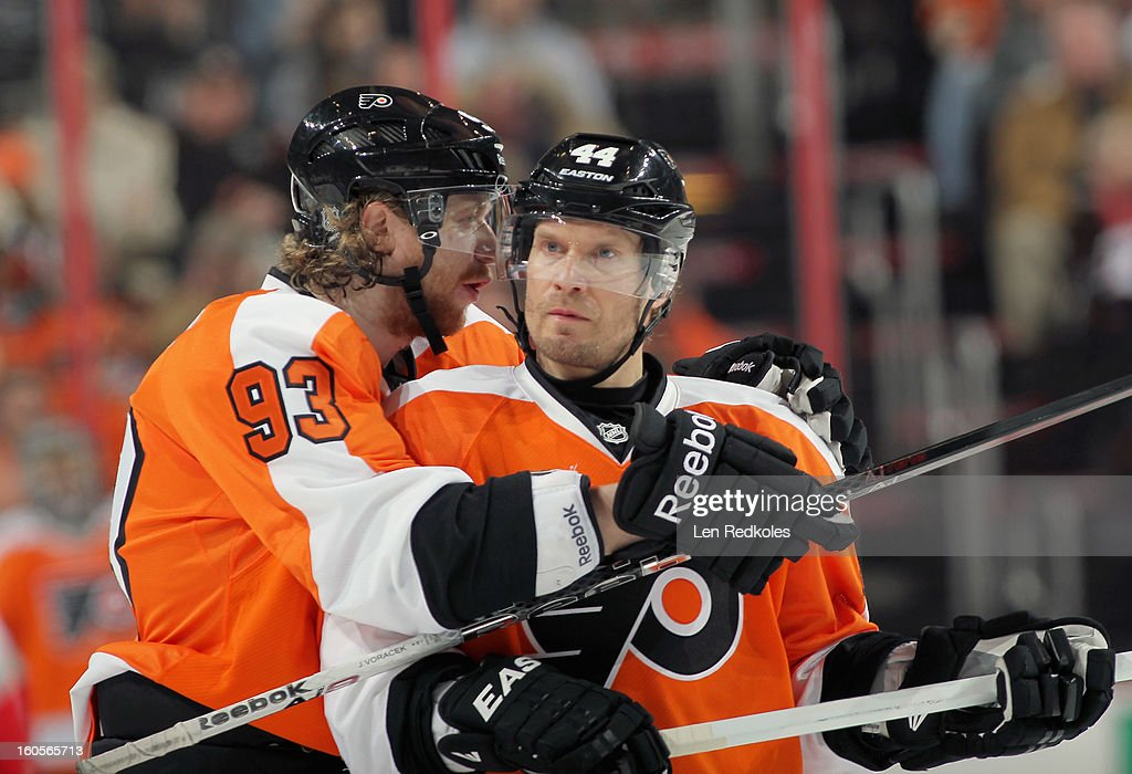 Jakub Voracek #93 and Kimmo Timonen #44 of the Philadelphia Flyers converse during a stoppage in play against the Carolina Hurricanes on February 2, 2013 at the Wells Fargo Center in Philadelphia, Pennsylvania. The Flyers went on to defeat the Hurricanes 5-3.