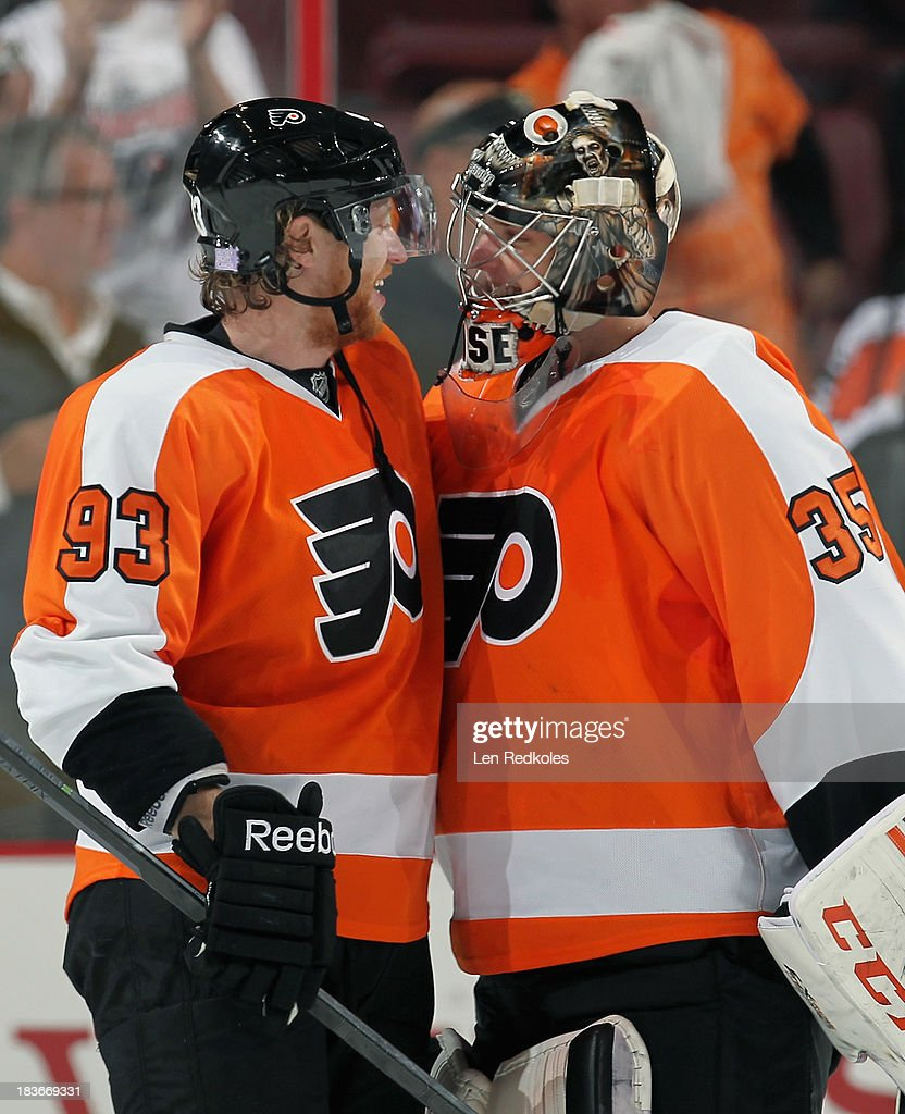 <a gi-track='captionPersonalityLinkClicked' href=/galleries/search?phrase=Jakub+Voracek&family=editorial&specificpeople=4111797 ng-click='$event.stopPropagation()'>Jakub Voracek</a> #93 and Steve Mason #35 of the Philadelphia Flyers celebrate after defeating the Florida Panthers 2-1 for their first win of the season on October 8, 2013 at the Wells Fargo Center in Philadelphia, Pennsylvania.