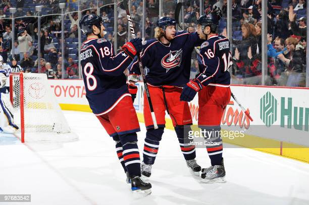 Jakub Voracek celebrates his goal with teammates RJ Umberger and Derick Brassard all of the Columbus Blue Jackets during the third period against the...