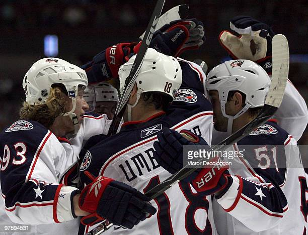 Jakub Voracek of the Columbus Blue Jackets and his teammates celebrate with Fedor Tyutin after Tyutin's secondperiod goal against the Anaheim Ducks...