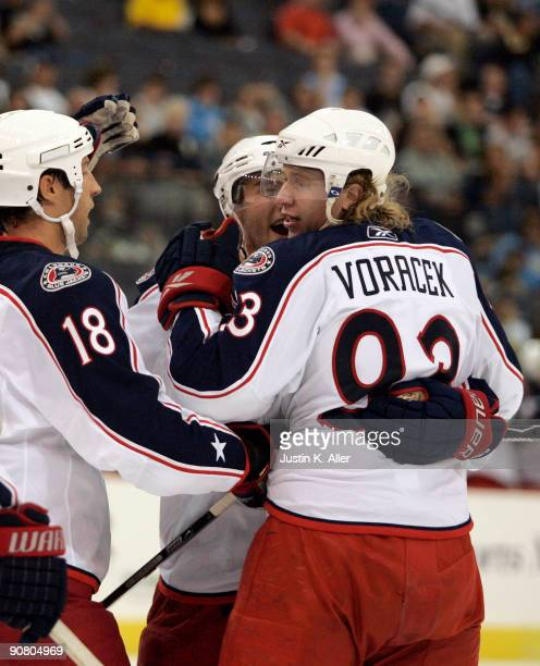 Jakub Voracek of the Columbus Blue Jackets celebrates with teammates after scoring in the first period against the Pittsburgh Penguins at Mellon...