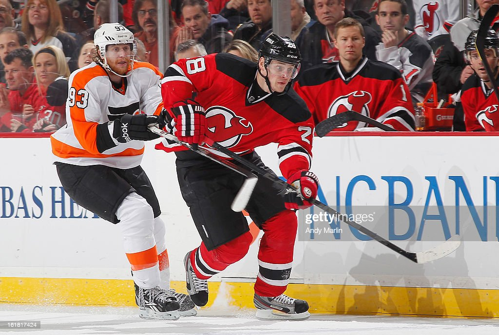 Jakub Voracek #93 of the Philadelphia Flyers and Anton Volchenkov #28 of the New Jersey Devils skate for position at the Prudential Center on February 15, 2013 in Newark, New Jersey.